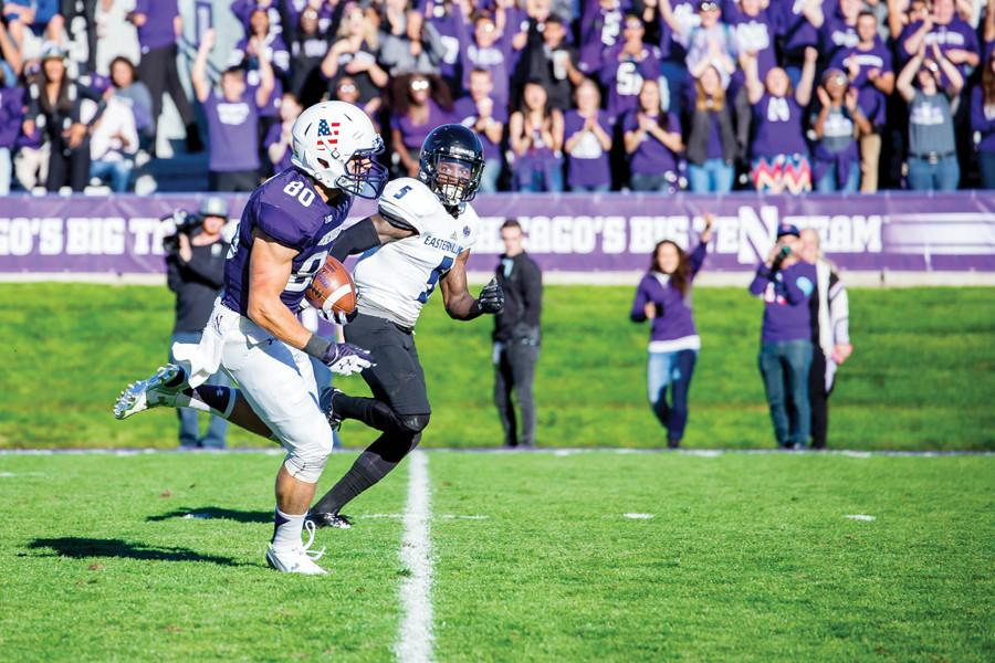 Austin Carr sprints past a defender in Northwestern's game against Eastern Illinois. The junior receiver and former walk-on has grown into a bigger role after receiving a scholarship before the season.