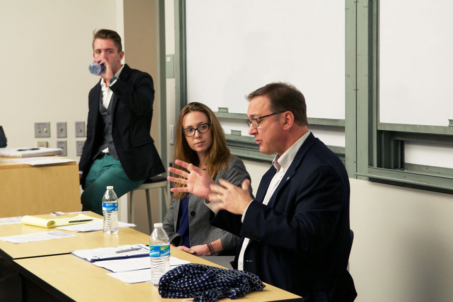 Dan Montgomery, president of the Illinois Federation of Teachers, speaks at a Educate, Discuss, Unite-sponsored debate Wednesday. More than 50 people attended.