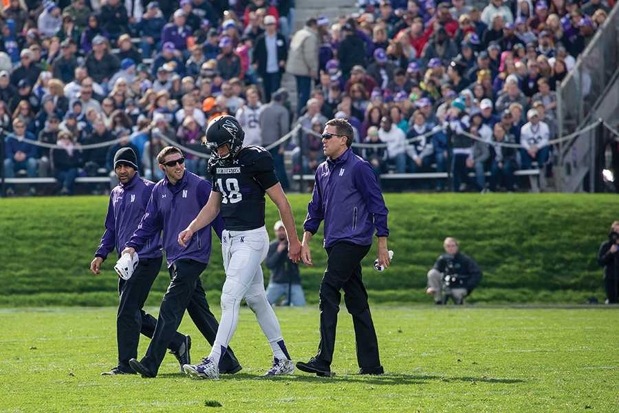 Clayton Thorson walks off the field after getting hurt. Although the redshirt freshman quarterback missed the majority of Saturday's win over Penn State, he is expected to be ready to play in the team's next game against Purdue.