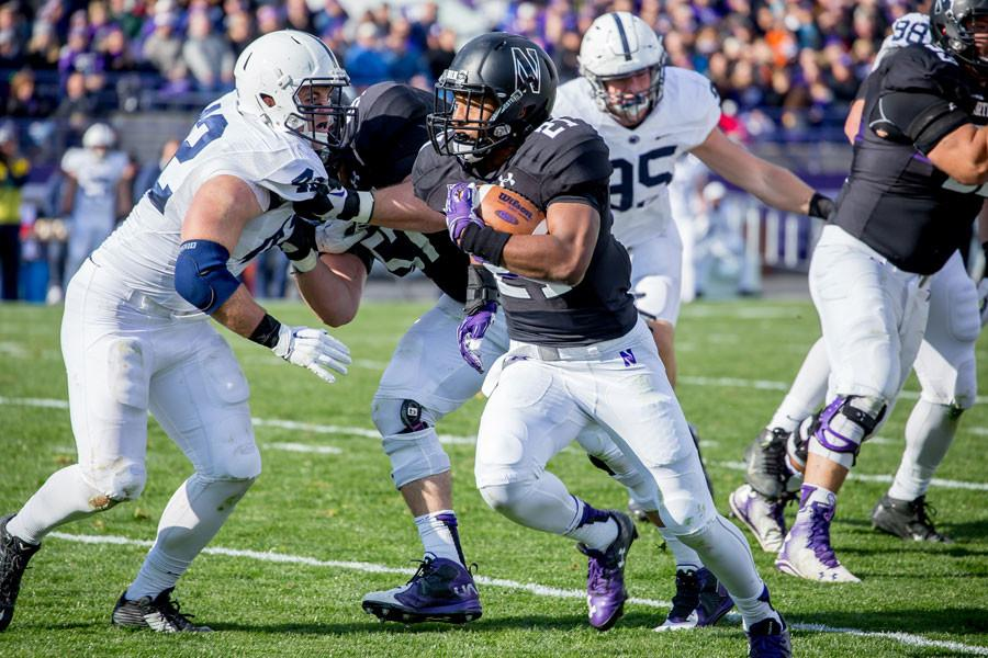 Justin Jackson sprints past a defender. The sophomore running back rushed for 116 yards and a touchdown in NU's 21-14 victory over Purdue.