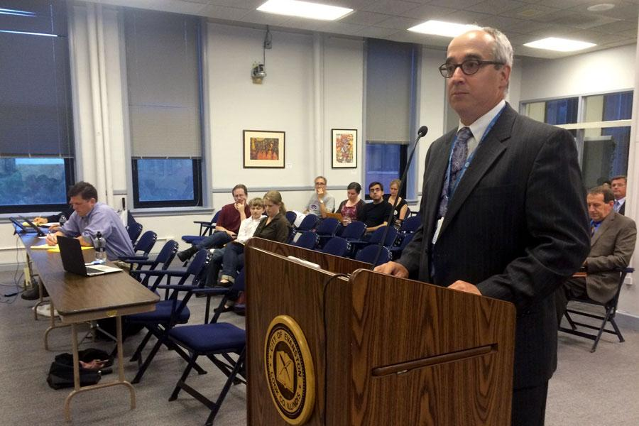 Marty Lyons, Evanston's chief financial officer, speaks at a City Council meeting. Lyons said the Illinois government has withheld fuel tax revenue from the city since July 1, when the state began its own fiscal year without a budget.