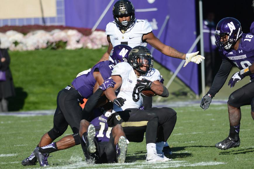 Junior+cornerback+Matthew+Harris+and+sophomore+safety+Godwin+Igwebuike+bring+down+Purdue+running+back+Markell+Jones.+Northwestern%27s+defense+came+up+with+many+crucial+stops+to+bail+out+the+Wildcats%27+struggling+offense.