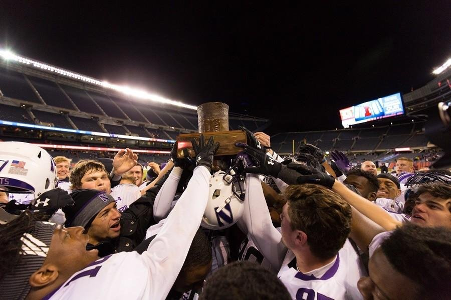 Northwestern+players+hoist+the+Land+of+Lincoln+Trophy%2C+awarded+to+the+winner+of+the+NU-Illinois+rivalry+game%2C+after+beating+Illinois+24-14.+The+Wildcats+improved+to+10+wins+for+just+the+fourth+time+in+program+history.