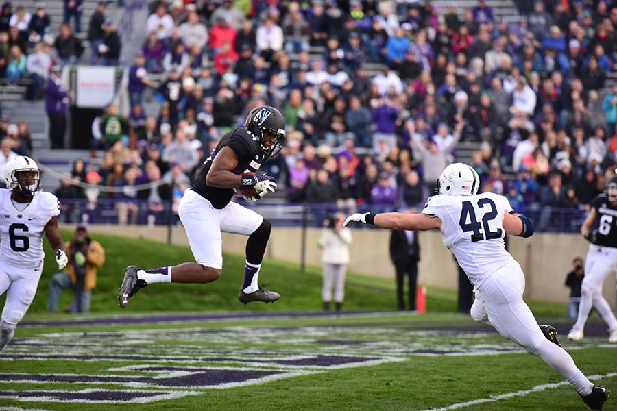 Senior wide receiver Christian Jones catches a touchdown pass in the second quarter. Saturday's game against Penn State resulted in a 23-21 win for the Cats.