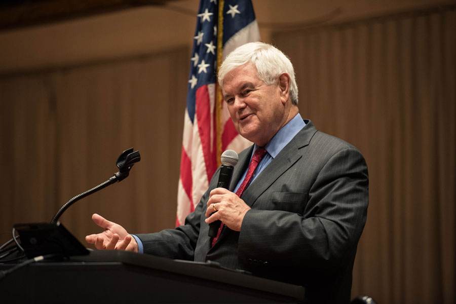 Former House Speaker Newt Gingrich addresses a bipartisan audience in the Louis Room in Norris University Center on Monday night. His talk, which touched on everything from potential nuclear war to racism, was met with a standing ovation and some pushback from the crowd.