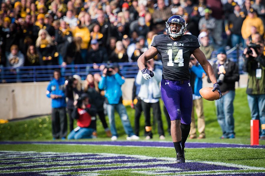 Christian Jones celebrates a touchdown against Iowa. The senior receiver has been a critical safety blanket for redshirt freshman quarterback Clayton Thorson.
