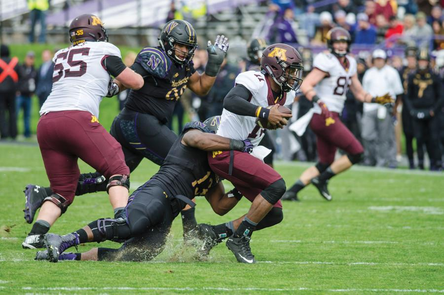 Deonte Gibson records a sack against Minnesota. The senior defensive end is a member of the Northwestern Leadership Council, helping set the tone for the team on a week-to-week basis.