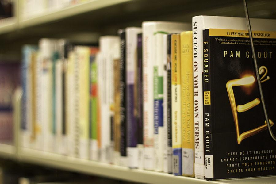 Books sit on a shelf at Evanston Public Library, 1703 Orrington Ave. Library officials aim to expand the library's collection next year to help increase resident visitation.