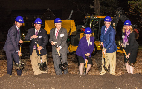 Northwestern administrators, trustees and a student dig shovels into soil at the site where the newest residential hall will be built. The University held a groundbreaking ceremony for the new building, 560 Lincoln, on Friday.