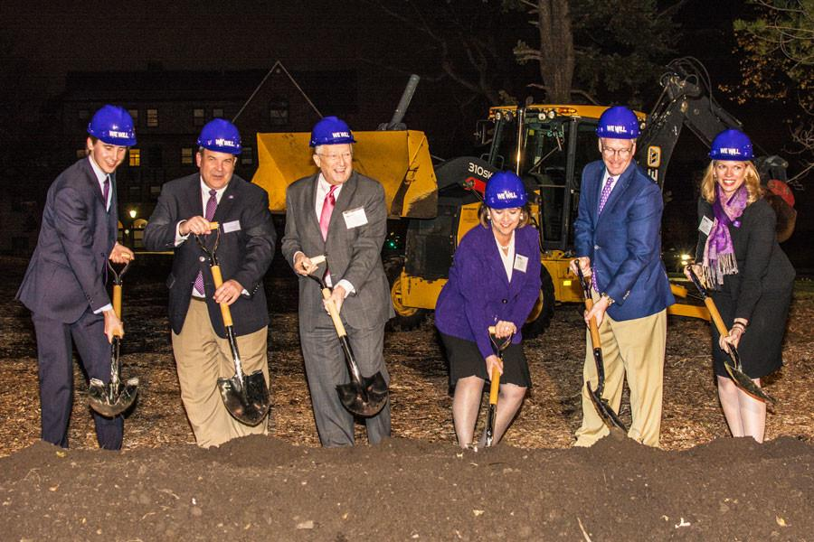 Northwestern+administrators%2C+trustees+and+a+student+dig+shovels+into+soil+at+the+site+where+the+newest+residential+hall+will+be+built.+The+University+held+a+groundbreaking+ceremony+for+the+new+building%2C+560+Lincoln%2C+on+Friday.