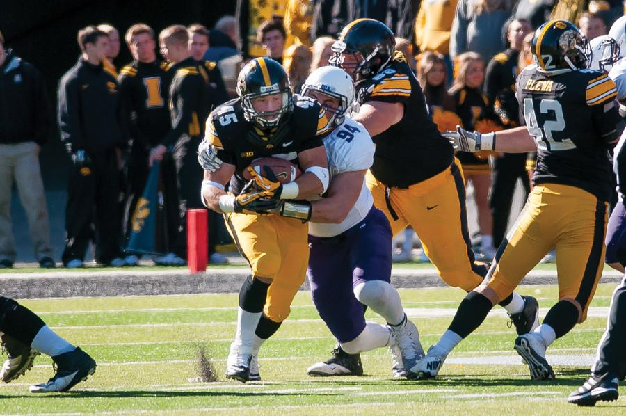 Dean Lowry brings down the ball carrier in last season's game against Iowa. The senior defensive end has steadily progressed by adding weight in each of his years at Northwestern.