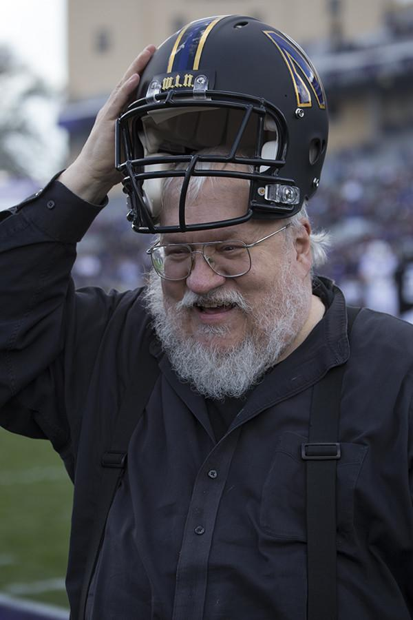 George R. R. Martin dons a football helmet during the second quarter of Northwestern's game against Penn State. The marching band honored the author with a Game of Thrones-themed halftime show.