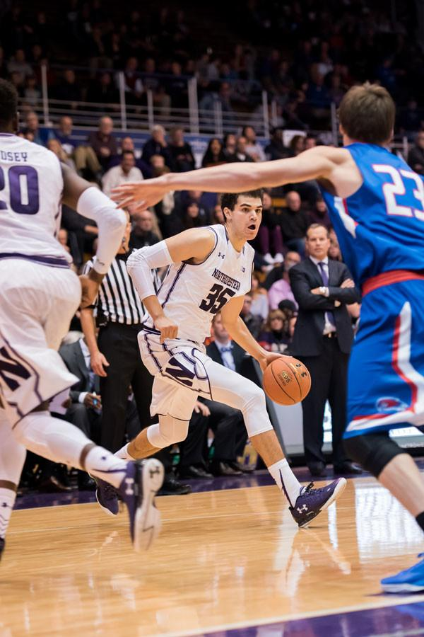 Aaron Falzon drives around a defender. The freshman sharpshooter drilled three three-point shots in the first five minutes of Wednesday's game against Fairfield.