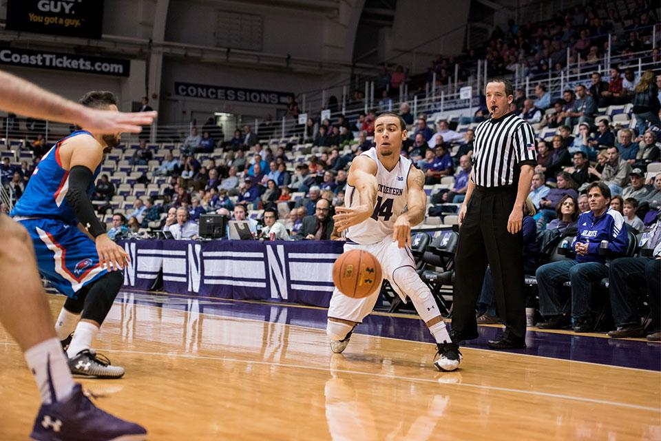 Tre Demps passes the ball inside. The senior guard chipped in 22 points and six assists while playing every minute in the Wildcats' win.