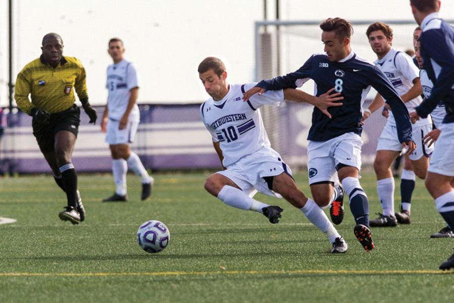 Joey Calistri shields off a defender. The senior forward will be leading the Cats' attack when the team travels to Wisconsin with a chance to snatch the regular season conference championship.