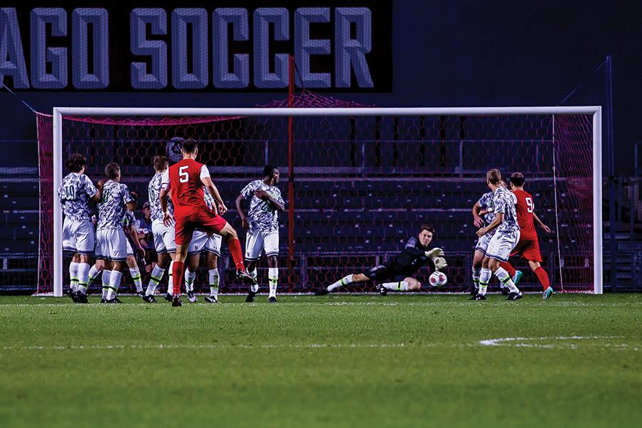 Senior+goalkeeper+Zak+Allen+dives+to+save+a+free+kick.+Allen+made+a+number+of+key+saves+but+was+unable+to+lift+the+Wildcats+to+victory%2C+ending+his+career+with+a+2-0+loss+to+Rutgers+in+the+Big+Ten+Tournament.