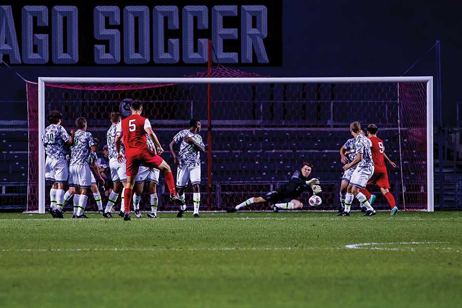 Senior goalkeeper Zak Allen dives to save a free kick. Allen made a number of key saves but was unable to lift the Wildcats to victory, ending his career with a 2-0 loss to Rutgers in the Big Ten Tournament.