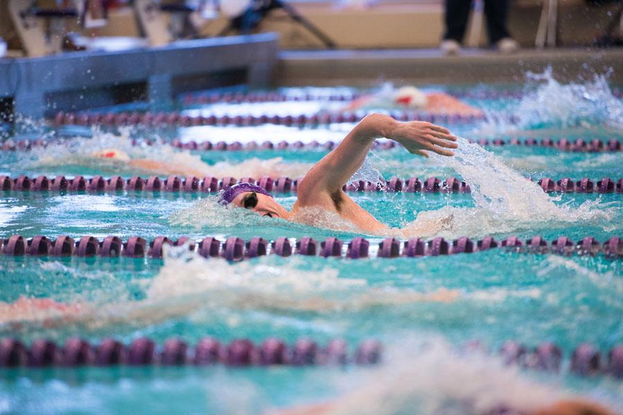 Carter Page reaches for his next stroke. The freshman swimmer will be able to compete in many different races this weekend as the Cats host a five-team event.
