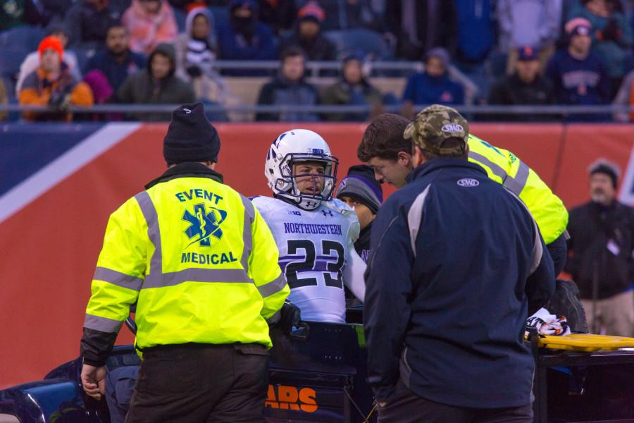 Senior+cornerback+Nick+VanHoose+is+carted+off+the+field+after+suffering+an+injury+during+the+second+quarter+Saturday.+VanHoose+will+not+return+to+the+game%2C+Northwestern+announced.%0A
