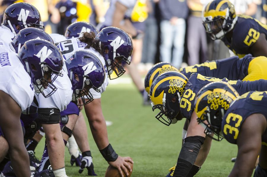 Northwestern's offensive line readies for a snap against Michigan.The unit will have its hands full against a talented Penn State defense.