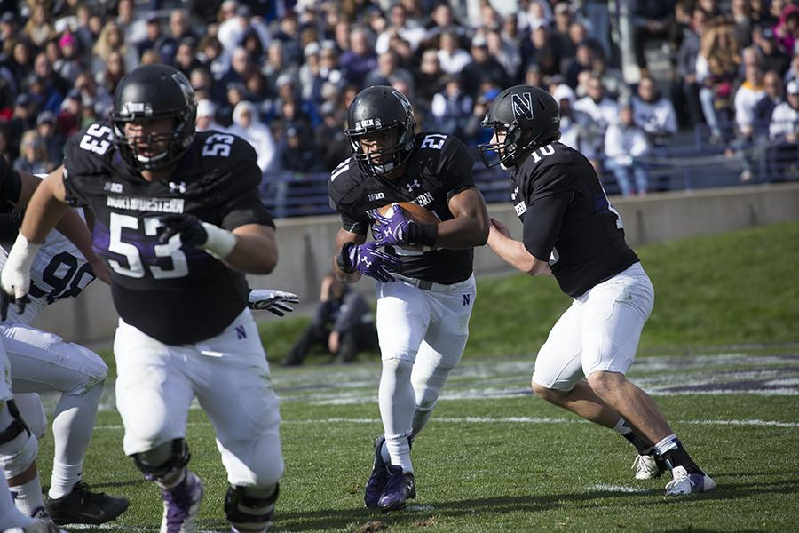 Justin Jackson takes a handoff during the first half of Saturday's game against Penn State. Jackson rushed for a career-high 186 yards on the ground in the 23-21 win.