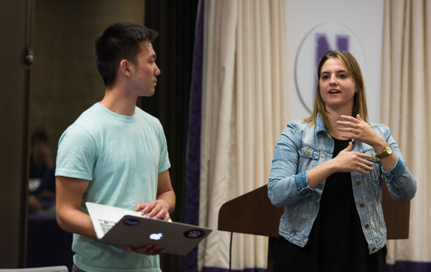 Weinberg seniors Kenny Mok and Mackenzie Schneider discuss Senate's funding model at its meeting Wednesday. The body will hear fall A-status funding proposals at its meeting next week.