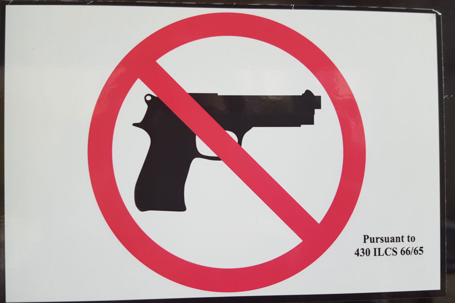 Guns-prohibited stickers were required to be placed on all public buildings in Illinois following concealed carry laws in 2013. Northwestern continues today to also train students in responding to active shooter situations.