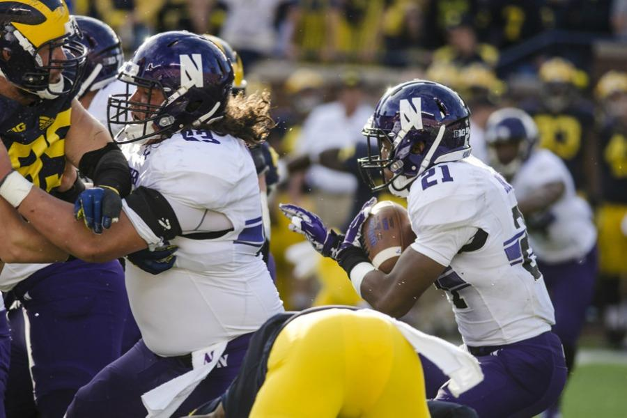 Justin Jackson charges toward the line against Michigan. The sophomore running back has had an inconsistent season mirroring Northwestern's success on the field.