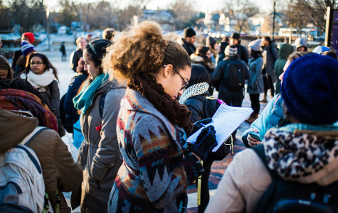 Students gather before marching to Sodexo administrative offices in solidarity with food service workers at NU. The group presented a petition calling for measures such as better treatment of workers and a guaranteed 40-hour work week as workers begin to renegotiate their contract with Sodexo.