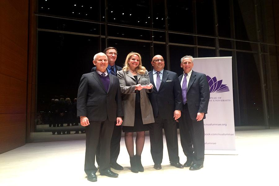 President+Morton+Schapiro+and+other+administrators+stand+with+SpaceX+President+Gwynne+Shotwell%2C+the+recipient+of+an+annual+award+from+the+Alumnae+of+Northwestern+University.+Shotwell+has+worked+at+SpaceX%2C+a+private+space+exploration+company%2C+since+2002.+