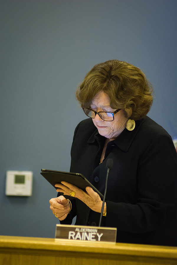 Ald. Ann Rainey (8th) reads from the agenda at a City Council meeting. Rainey, whose ward houses the potential Howard Street Theater, voiced support at Monday's council meeting for Strawdog Theatre Company's involvement in the project.