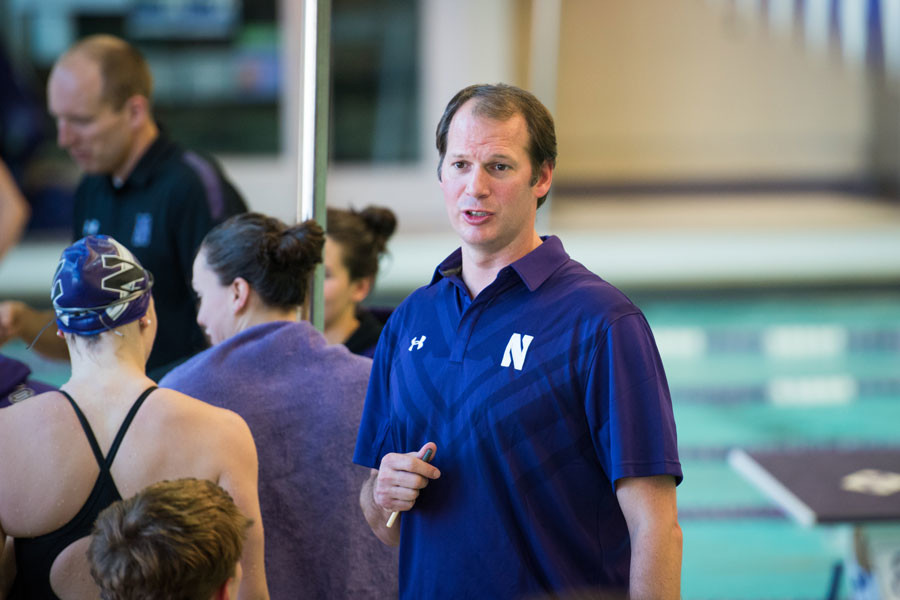 Coach Jarod Schroeder looks over toward his athletes. Schroeder has been leading the way for Northwestern since 2009 when he was promoted after serving as an assistant coach for a year. He said since he no longer competes in the water, coaching is now his competitive outlet.
