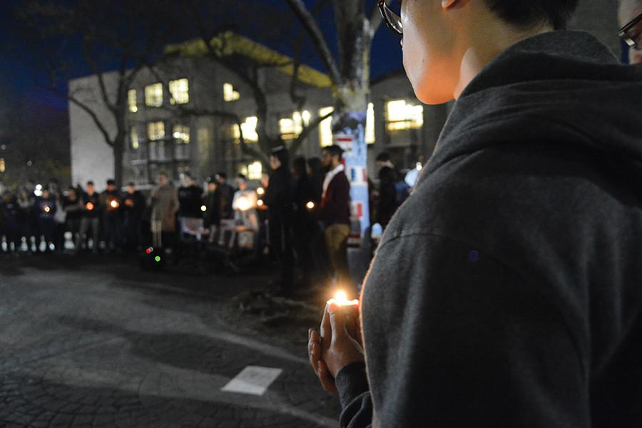 Members+of+the+Northwestern+community+gather+and+pray+at+The+Rock+at+a+candlelight+vigil.+International+Student+Association+and+Interfaith+hosted+the+vigil+Sunday+evening+to+support+those+who+were+affected+by+the+recent+terrorist+attacks+worldwide.