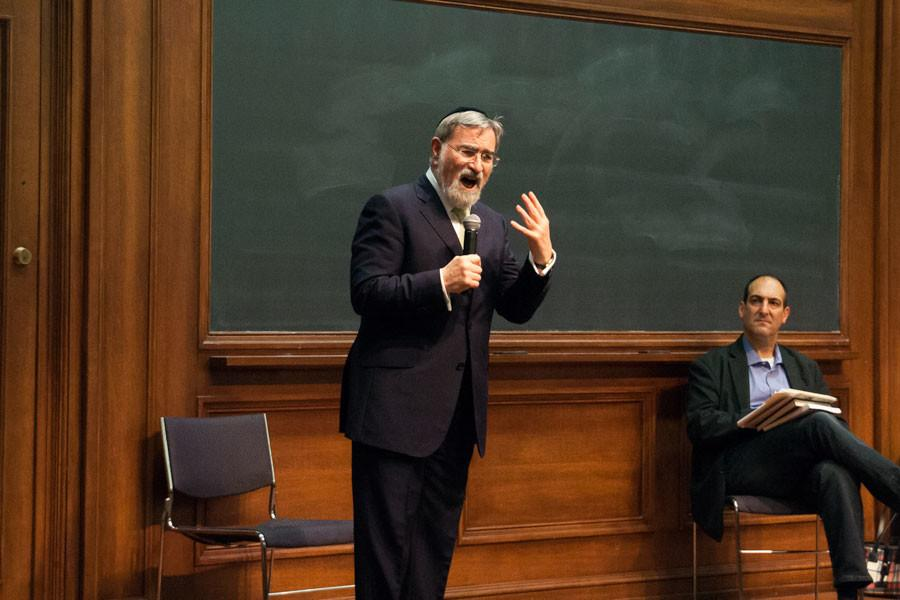 Rabbi Jonathan Sacks addresses students at Harris Hall on Wednesday. Sacks discussed confronting religious violence through tolerance and said people can prevent violence by recognizing that those with different religious beliefs are not enemies.