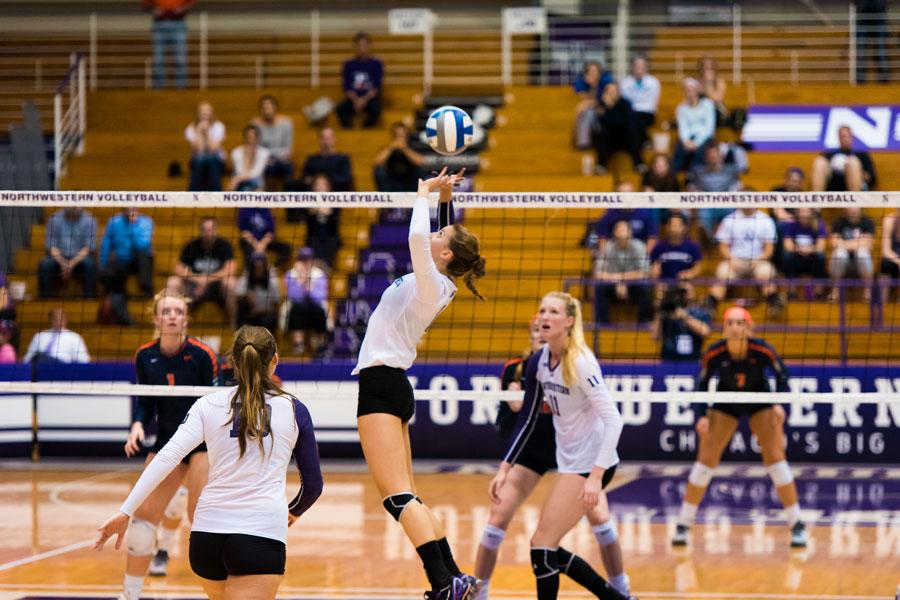 Taylor Tashima sets up a teammate for a spike. The sophomore setter had 53 assists against Minnesota, the most she's had in a conference game all season, and her third highest total on the year.