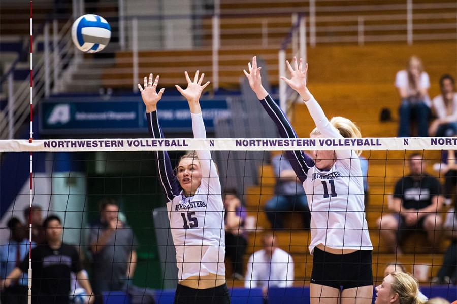 Juniors Kayla Morin and Maddie Slater get in place to block a return. The duo ranks second and third on the team in kills this season, with Morin totaling 251 and Slater notching 204.