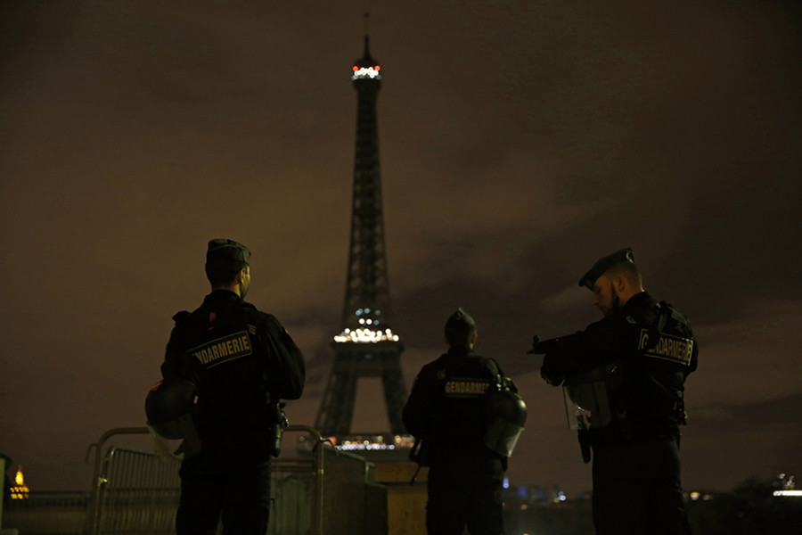Armed+police+stand+guard+on+Saturday%2C+November+14%2C+2015%2C+overlooking+the+Eiffel+Tower%2C+which+was+kept+dark+in+honor+of+those+who+died+in+the+terrorist+attacks+in+Paris+on+Friday.+France+declares+a+national+state+of+emergency+after+at+least+120+people+were+killed+in+gun+and+bomb+attacks.+