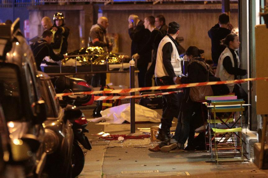 Medics+stand+by+victims+in+a+Paris+restaurant+on+Nov.+13%2C+2015%2C+after+a+reported+shootout.