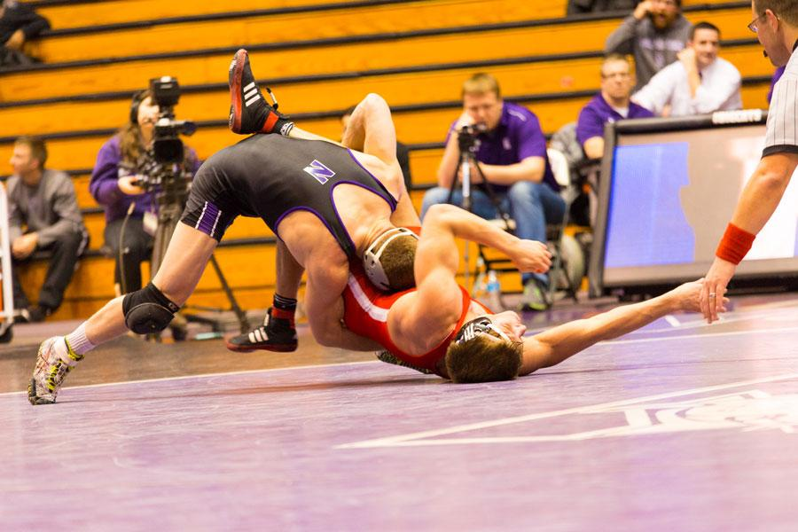 A Wildcat takes down his opponent. NU's wrestlers experienced varying results over the weekend, with senior Dominick Malone having the best performance.