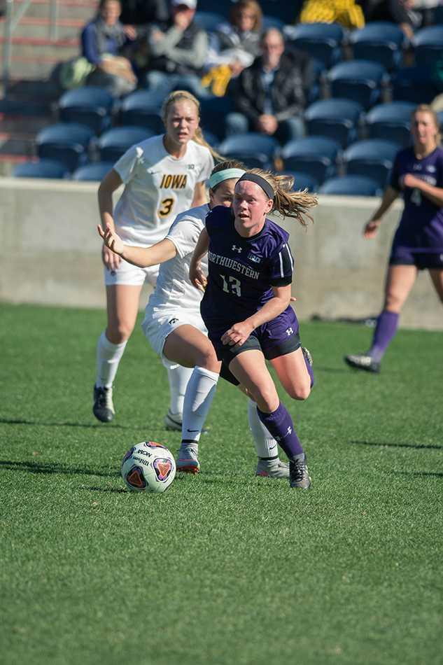 Michelle Manning dribbles upfield during an October game against Iowa. The sophomore forward scored the game-winning goal in double overtime during Saturday's match against Washington State.
