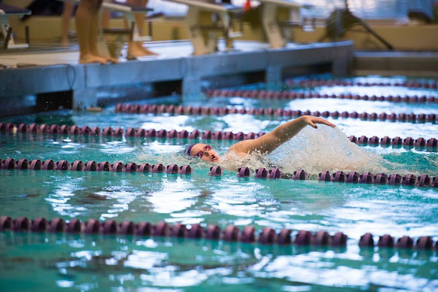 Lacey Locke competes. The junior claimed first place in the 50-yard backstroke championship final on the third day of the TYR Invitational.