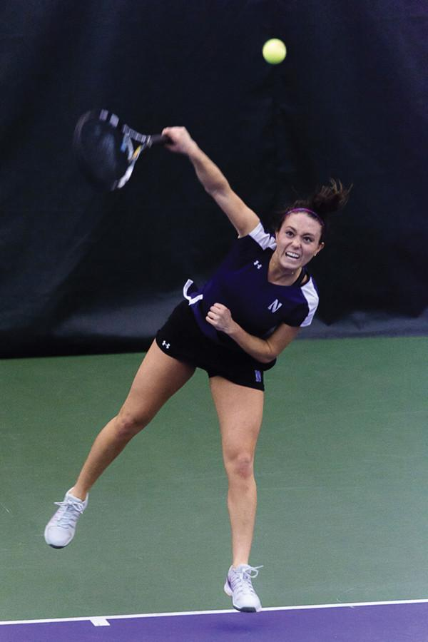 Junior+Manon+Peri+hits+a+serve.+Peri+will+play+doubles+at+this+weekend%E2%80%99s+Wildcat+Fall+Duals%2C+her+first+action+since+a+February+knee+injury+cut+her+2014-2015+season+short.%0A