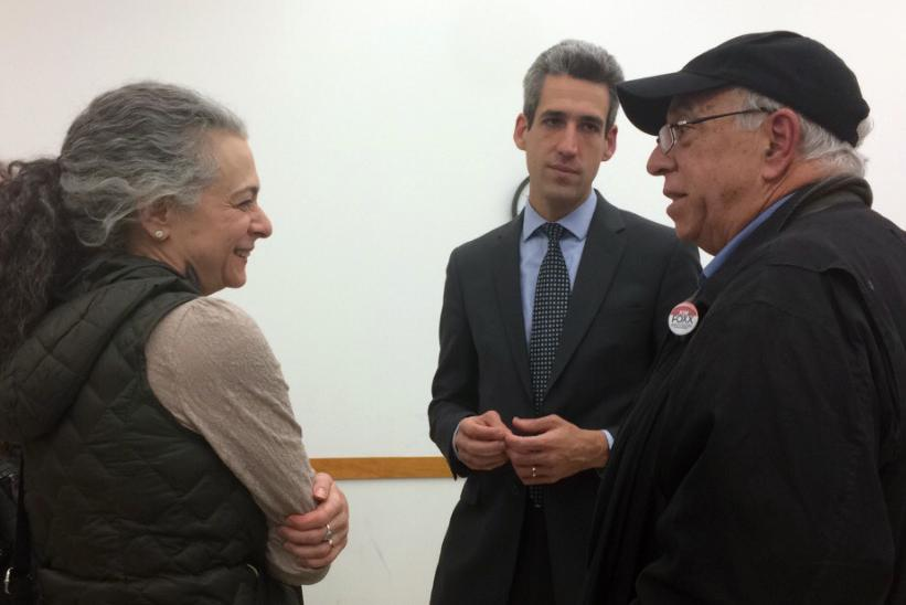 State Sen. Daniel Biss talks with constituents after a town hall meeting at the Levy Center on Thursday night. At the meeting, he addressed concerns about the five-month budget crisis and the impact on higher education.