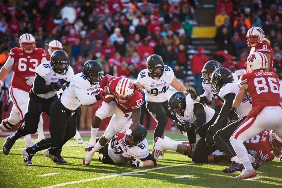 Anthony Walker (18) makes a tackle against Wisconsin. Walker was recently named first-team all-Big Ten, and some of his teammates say he deserves an All-American nod.