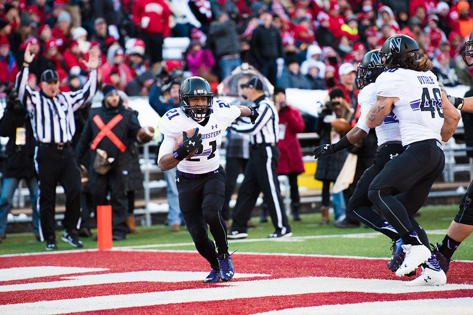 Justin Jackson celebrates in the end zone after scoring a touchdown against Wisconsin. The sophomore running back finished the regular season 14th in the country with 1,344 rushing yards.