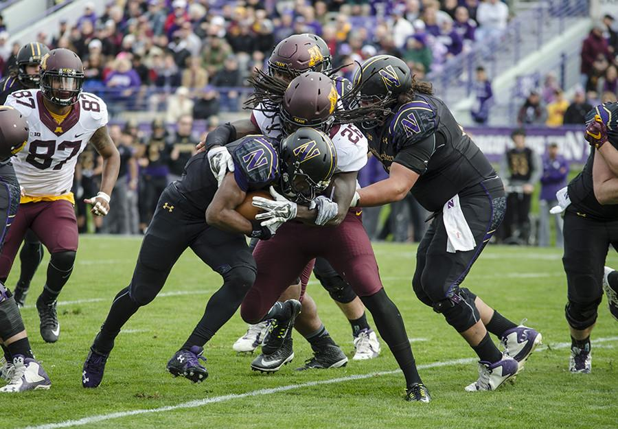 Justin Jackson runs into a Minnesota defender. The sophomore running back will be tasked with keeping Northwestern out of third-and-long situations against a tough Tennessee defense.