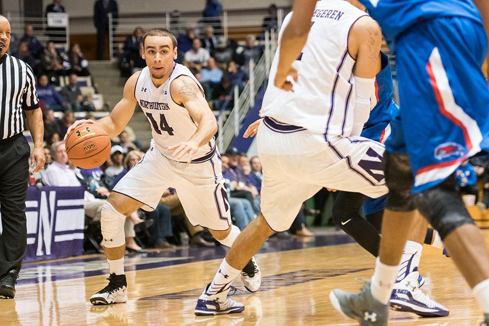 Photo caption: Tre Demps drives towards the basket. The senior guard was instrumental in Northwestern's victory over Nebraska Wednesday, scoring 17 points in 36 minutes.