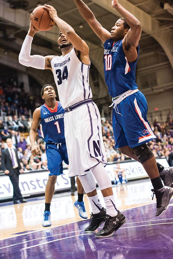 Sanjay Lumpkin battles in the paint. In the first half, the junior forward sparked an otherwise lackluster offensive performance for the Wildcats.