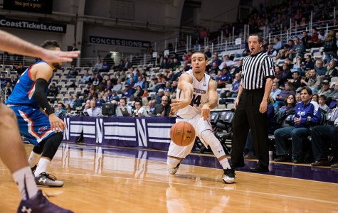 Tre Demps passes around a defender. After a slow start, the senior guard exploded for 23 points and a career-high nine rebounds in the dominant win over Chicago State.
