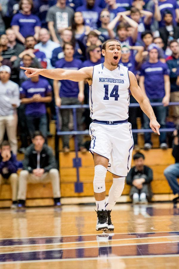 Tre+Demps+calls+out+a+play+as+he+runs+to+the+offensive+side.+The+senior+guard+had+17+points+in+Northwestern%E2%80%99s+dominant+win+over+Sacred+Heart.